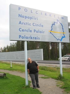 Tony holding up the Arctic Circle sign